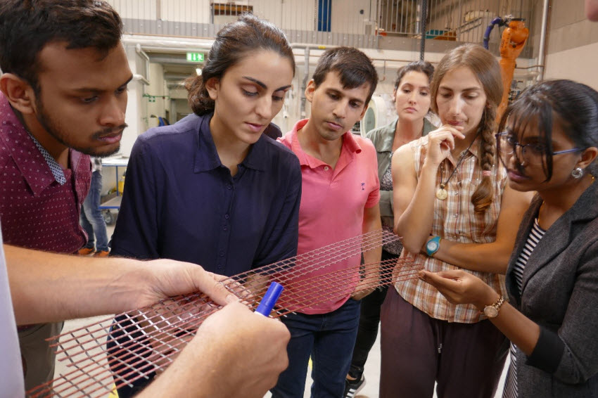 Participants of the GRK 2250/1 International Summer School observing two different types of carbon textile