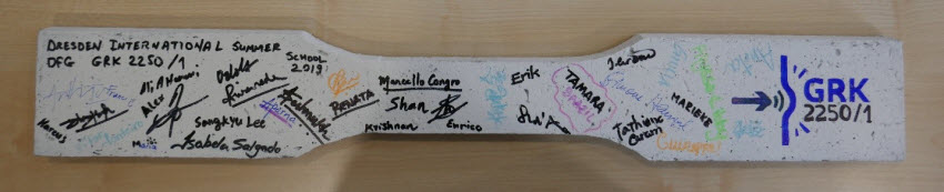 Coupon specimen of SHCC signed by all the participants of the GRK 2250/1 International Summer School