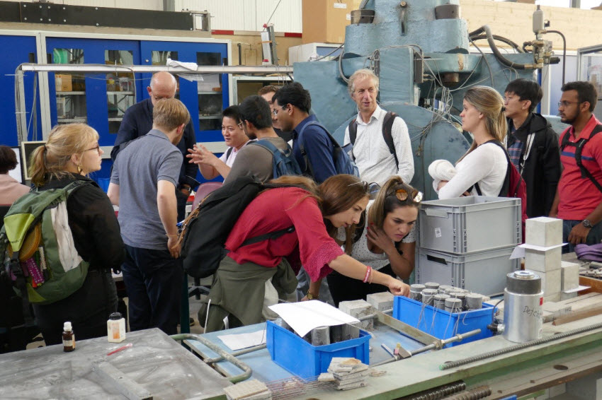 Participants of the GRK 2250/1 International Summer School being guided in the Otto-Mohr laboratory