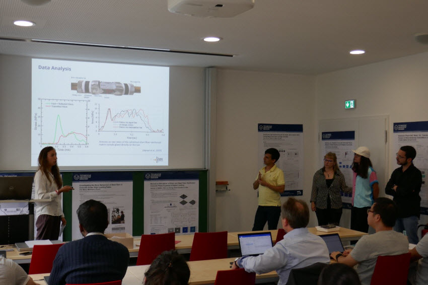 Participants of the GRK 2250/1 International Summer School presenting their experimental findings in teams
